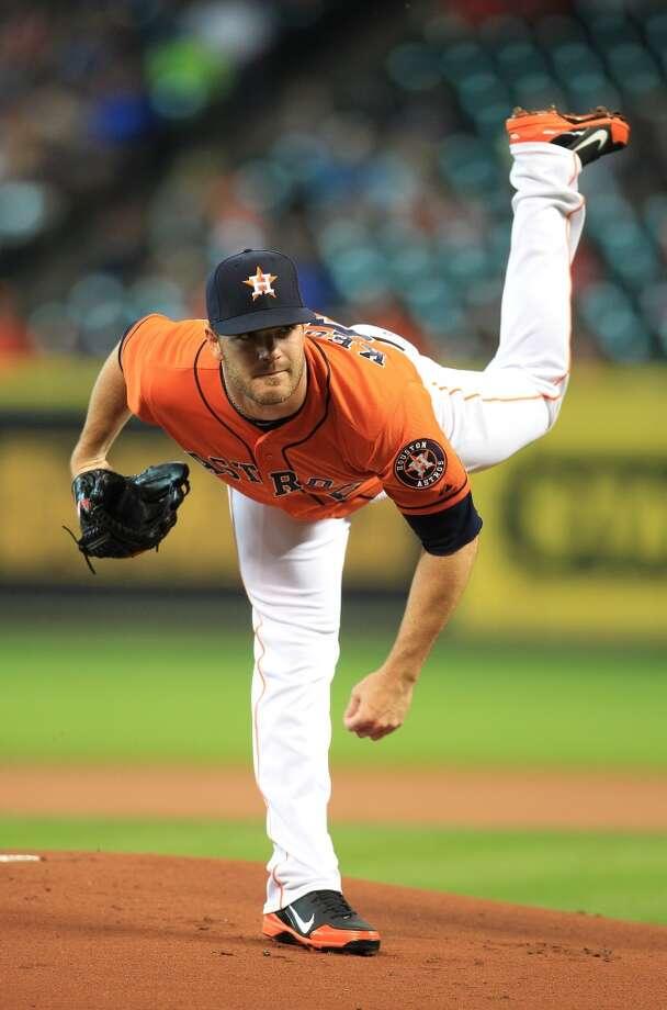 Astros pitcher Dallas Keuchel throws against the Rangers.