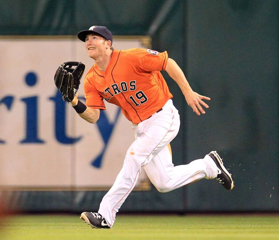 Astros outfielder Robbie Grossman prepares to make a catch for an out against the Rangers.