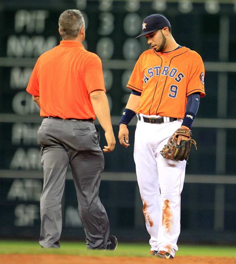 Astros trainer Nate Lucero checks on shortstop Marwin Gonzalez.