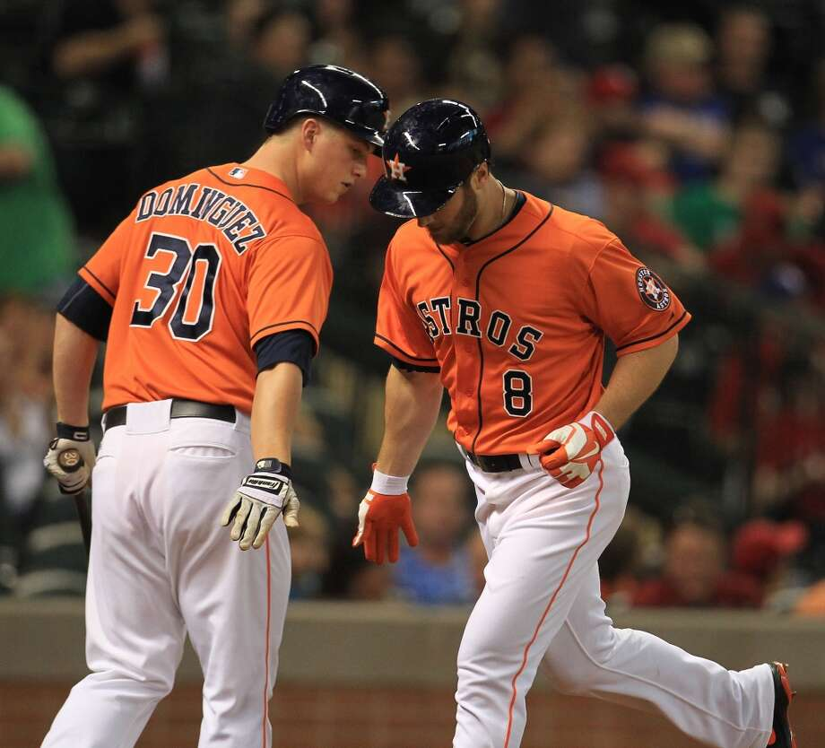 Trevor Crowe of the Astros is congratulated by teammate Matt Dominguez after hitting a home run during the second inning.