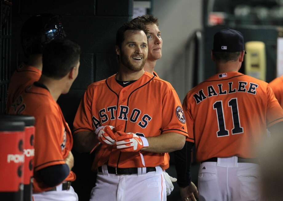 Trevor Crowe of the Astros celebrates with his teammates in the dugout after hitting a home run during the second inning.