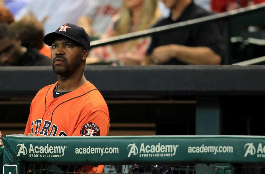 Astros manager Bo Porter watches his team play the Rangers from the dugout.