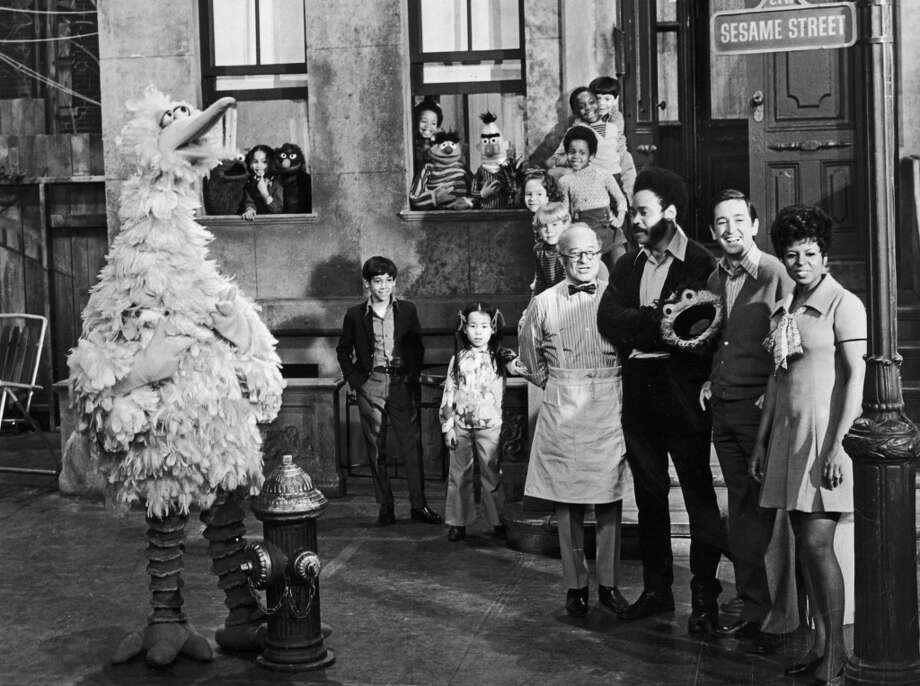 Did you watch ''Sesame Street'' in the early years, when Cookie Monster didn't care about healthy eating, and Elmo wasn't around to hog the Muppet limelight?   Here's a look back at the show, which just announced that a ''new neighbor'' is joining HBO.
