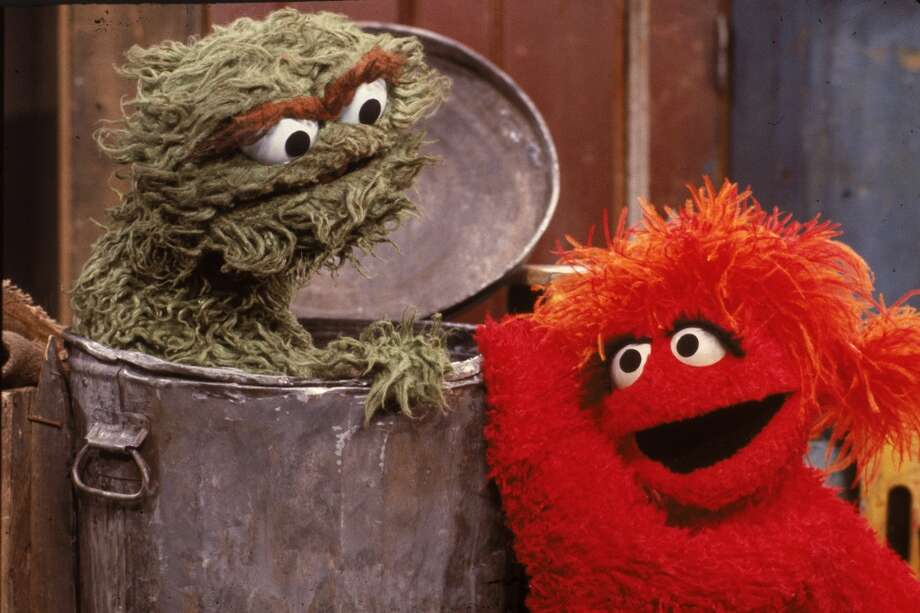 ''Oscar the Grouch'' (left) didn't always resemble dried cannabis. He was originally orange in the first season.
