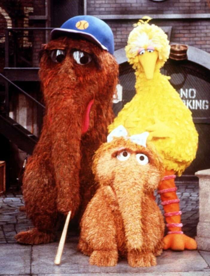 For years, Snuffleupagus (left), was Big Bird's imaginary friend, whom grown-ups on the show never saw. But when child molestation became a bigger media issue in the '80s, ''Sesame Street'' decided to make Snuffy real. That was to encourage kids to confide in adults, even when they worried their story wouldn't be believed.