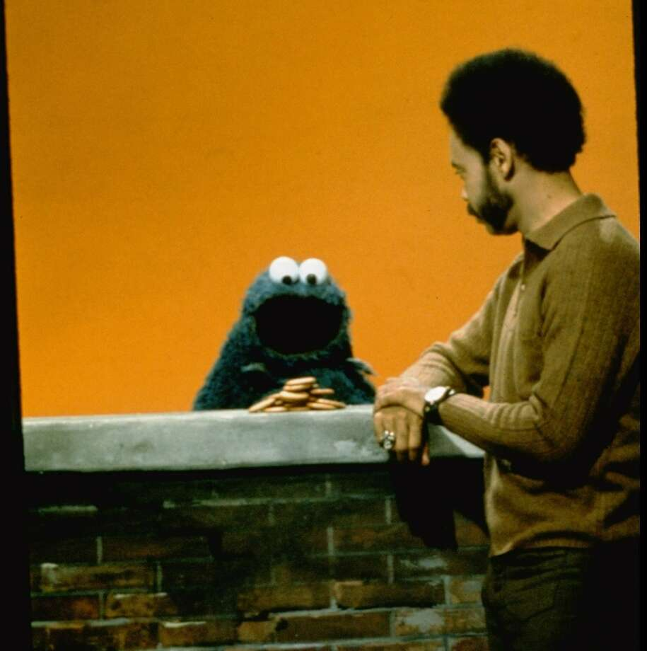 Cookie Monster has gone through some changes too. In the '70s, he gobbled cookies with abandon and rabid, googly eyes. He's pictured around 1970, with actor Matt Robinson.