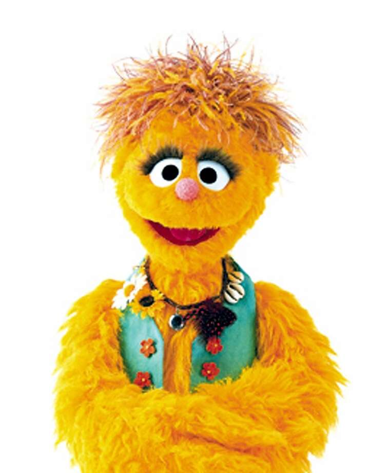 Kami was the world's first H.I.V.-positive Muppet, making her debut in 2002 on the South African version of ''Sesame Street''. She was part of the show's effort to teach kids about a nation and continent ravaged by the AIDS epidemic.