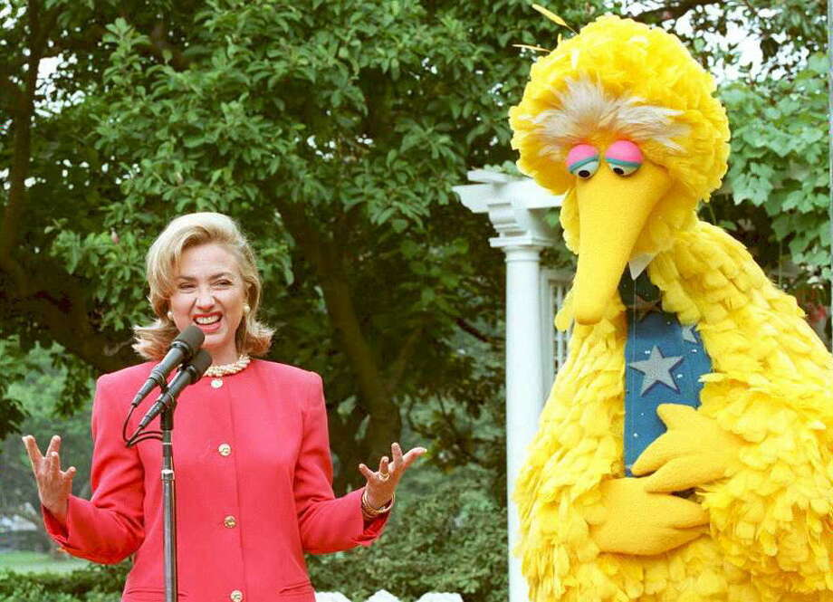 One of the best things about ''Sesame Street'' is its ability to make rich, powerful people seem down-to-earth. Here's then-First Lady Hilary Clinton speaking at the White House in 1995 with Big Bird on the benefits of public broadcasting. Photo: JAMAL WILSON, AFP/Getty Images / AFP/Getty Images