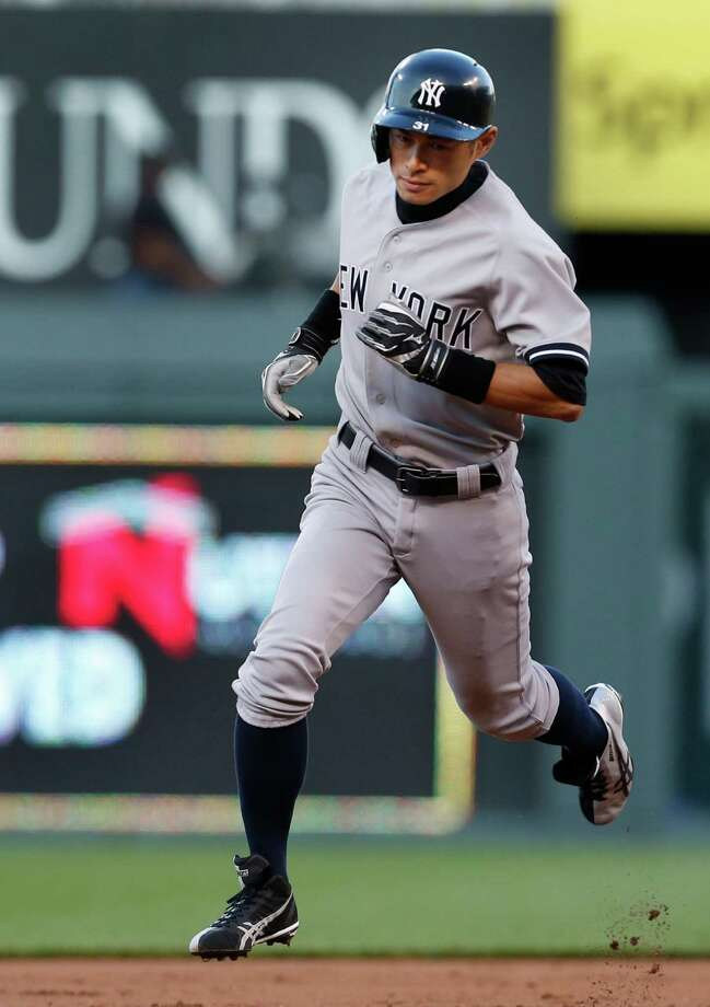 New York Yankees right fielder Ichiro Suzuki rounds the bases after hitting a two-run home run during the second inning of a baseball game against the Kansas City Royals at Kauffman Stadium in Kansas City, Mo., Friday, May 10, 2013. (AP Photo/Orlin Wagner) Photo: Orlin Wagner
