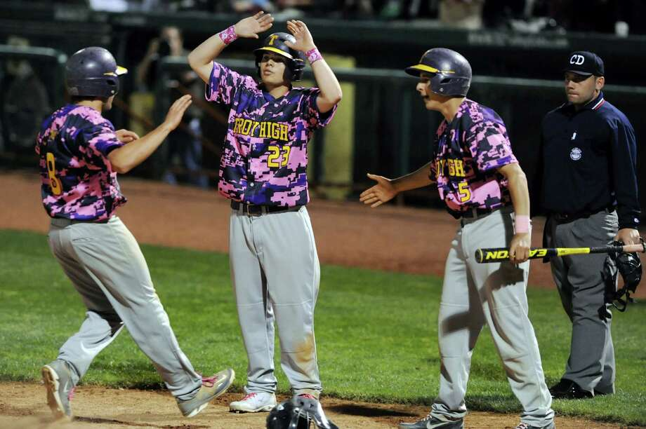 Troy's Jeramy Vandenburg, left, crosses home plate and celebrates with teammates Mchael Yamin, center, and Ben Julian during their Coaches vs. Cancer baseball game against CBA on Friday, May 10, 2013, at Joseph L. Bruno Stadium in Troy, N.Y. Troy wins 5-2. (Cindy Schultz / Times Union) Photo: Cindy Schultz / 00022362A