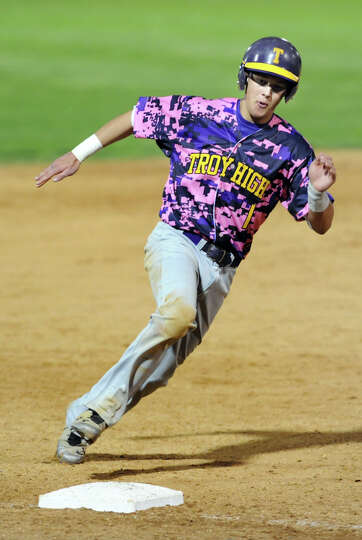 Troy's Kyle Halusic rounds third base during their Coaches vs. Cancer baseball game against CBA on F