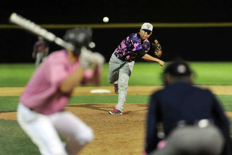 Troy's Christian Maldonando, center, releases a pitch during their Coaches vs. Cancer baseball game