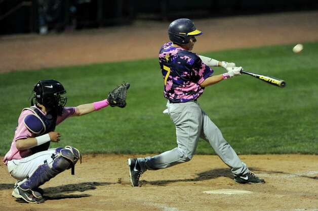 Troy's Dan LeClair, right, connects with the ball during their Coaches vs. Cancer baseball game against CBA on Friday, May 10, 2013, at Joseph L. Bruno Stadium in Troy, N.Y. (Cindy Schultz / Times Union) Photo: Cindy Schultz / 00022362A
