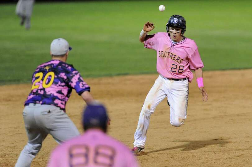 CBA's Gus Flores, right, cant's beat the ball thrown over his shoulder and gets out at third from Tr
