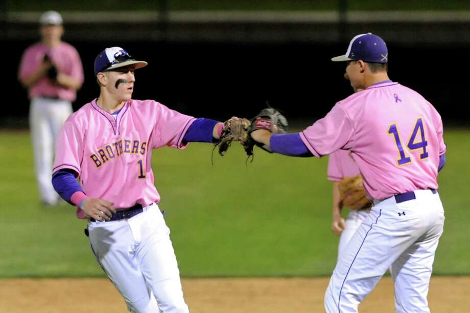 CBA's shortstop Chase Crawford, left, celebrates with pitcher Ned Monthie after getting out a runback at second during their Coaches vs. Cancer baseball game against Troy on Friday, May 10, 2013, at Joseph L. Bruno Stadium in Troy, N.Y. (Cindy Schultz / Times Union) Photo: Cindy Schultz / 00022362A