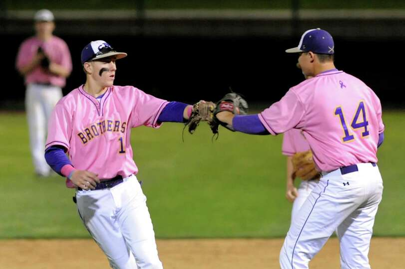 CBA's shortstop Chase Crawford, left, celebrates with pitcher Ned Monthie after getting out a runbac
