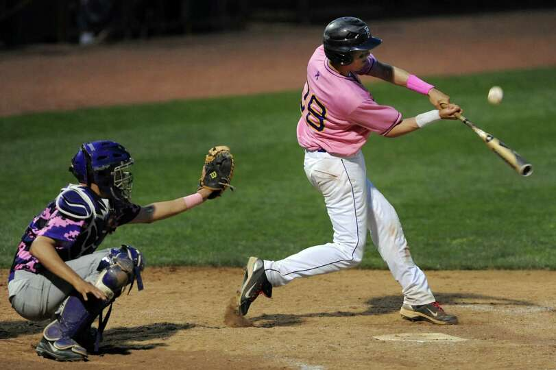 CBA's Gus Flores connects with the ball during their Coaches vs. Cancer baseball game against Troy o