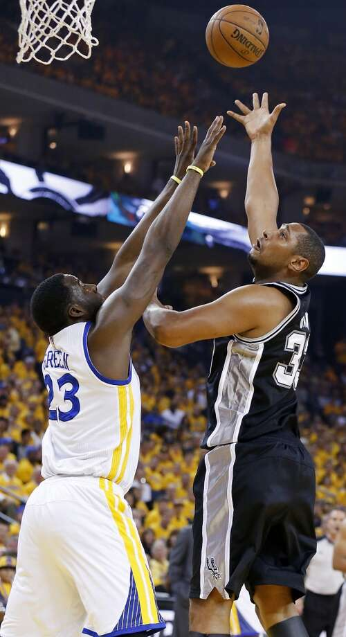 The Spurs' Boris Diaw shoots over the Warriors' Draymond Green during first half action of Game 3 in the Western Conference semifinals Friday May 10, 2013 at Oracle Arena in Oakland, CA.