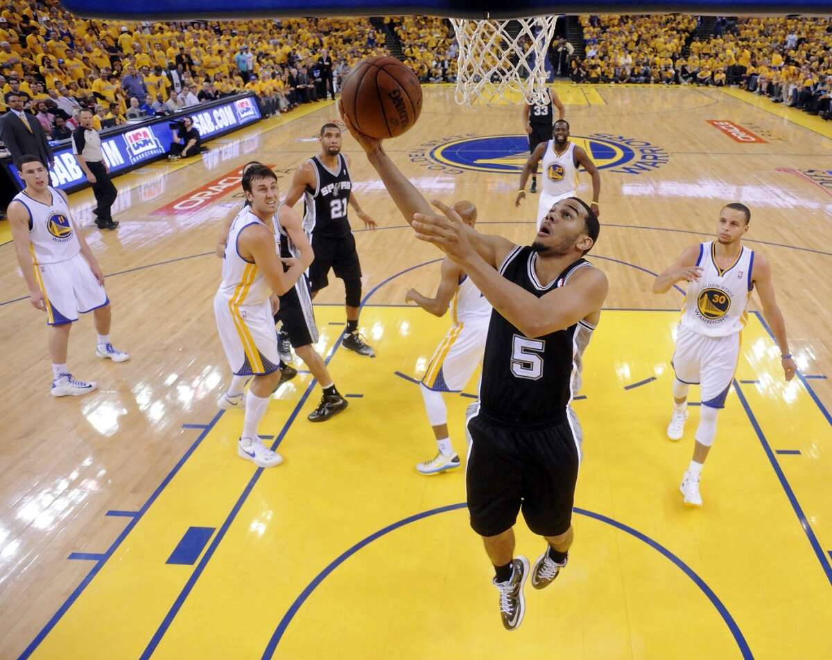 The Spurs' Cory Joseph shoots during first half action of Game 3 in the Western Conference semifinals against the Warriors Friday May 10, 2013 at Oracle Arena in Oakland, CA.