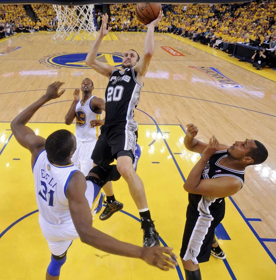 The Spurs' Manu Ginobili shoots over the Warriors' Festus Ezeli during first half action of Game 3 in the Western Conference semifinals Friday May 10, 2013 at Oracle Arena in Oakland, CA.