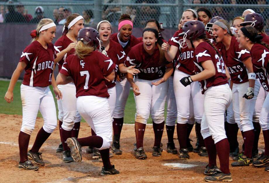 Merris Schroeder (7) has a welcoming committee after homering in the sixth inning to give Cy-Fair the lead in its comeback win over Cinco Ranch in the series opener. Photo: J. Patric Schneider, Freelance / © 2013 Houston Chronicle