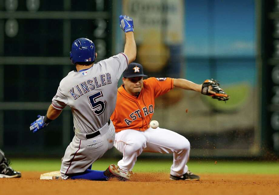 Ian Kinsler of the Rangers slides safely into second base in the seventh inning as Jose Altuve of the Astros is unable to make the tag Friday. Photo: Scott Halleran / Getty Images