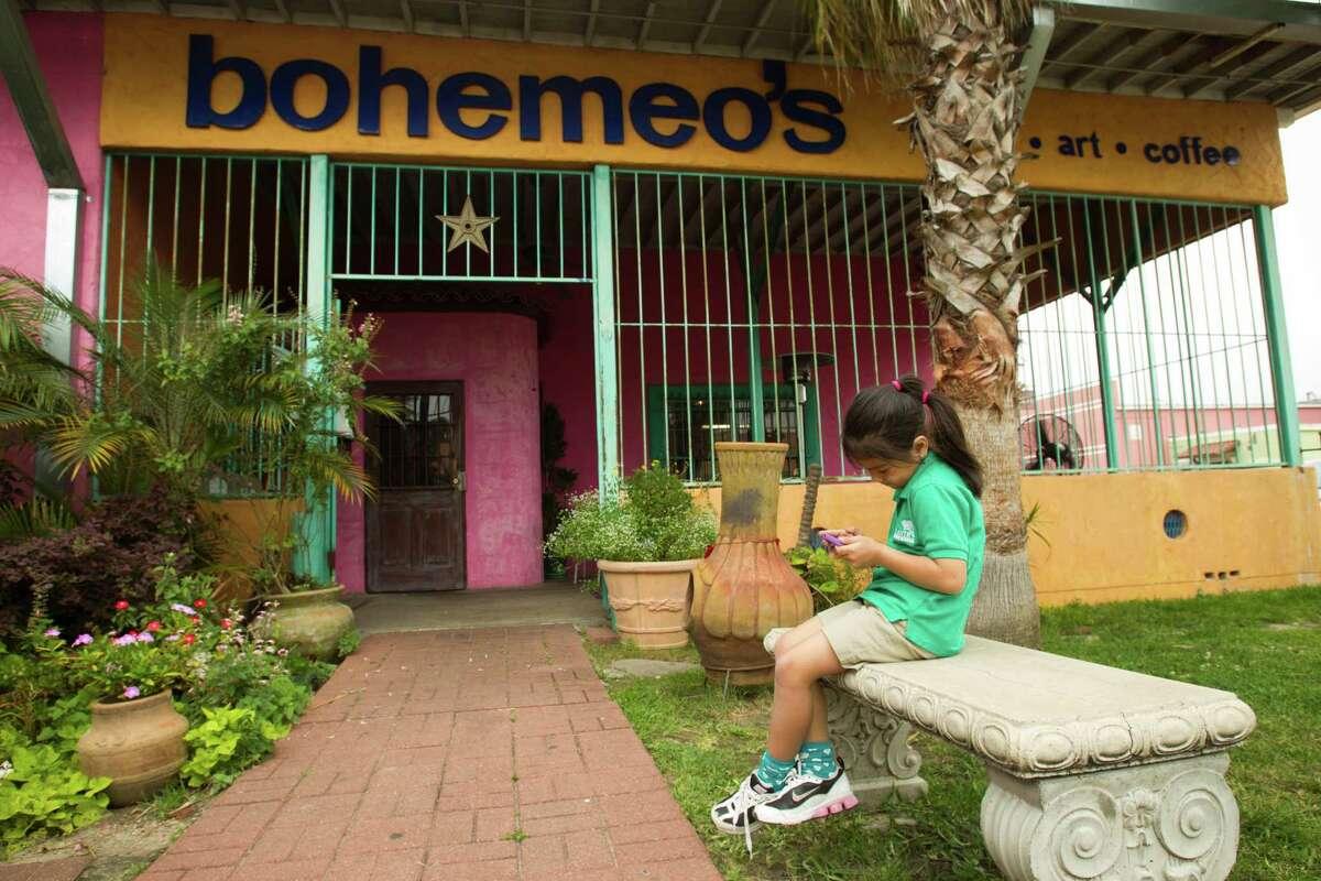 Six-year-0ld Umi Dealejandro enjoys the courtyard at Bohemeo's.