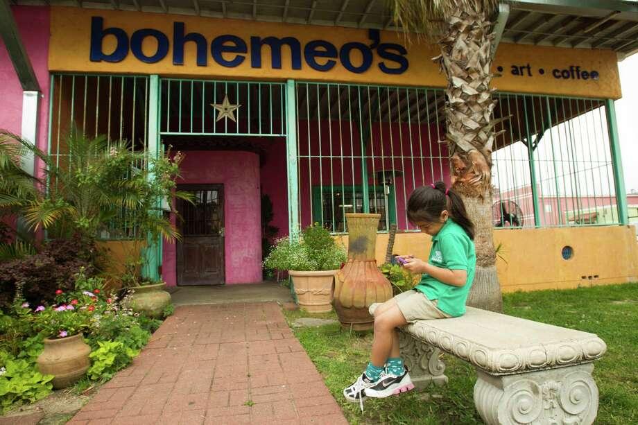 Six-year-0ld Umi Dealejandro enjoys the courtyard at Bohemeo's. Photo: Brett Coomer, Staff / © 2013 Houston Chronicle