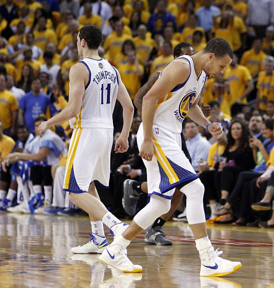 Stephen Curry (right) sprained his left ankle, the same one he hurt in the first round, late in Game 3. Photo: Carlos Avila Gonzalez, The Chronicle