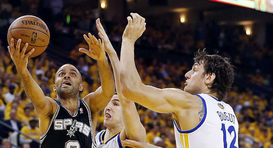 Tony Parker shot 13 of 23 from the field in Friday's Game 3 and led the Spurs with 32 points in their 102-92 victory over the Warriors in Oakland.  Edward A. Ornelas / San Antonio Express-News