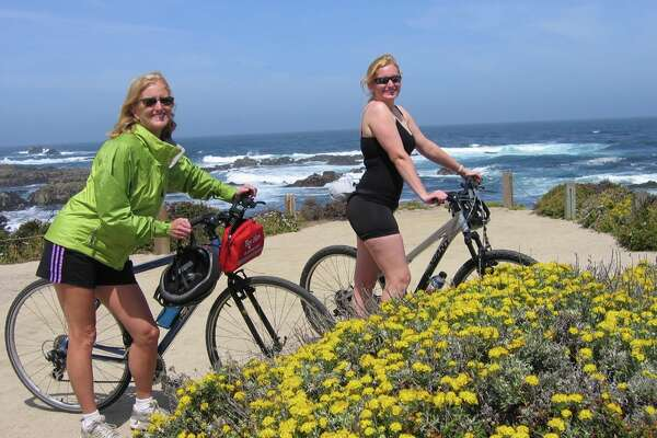 Some mothers and daughters go biking together.