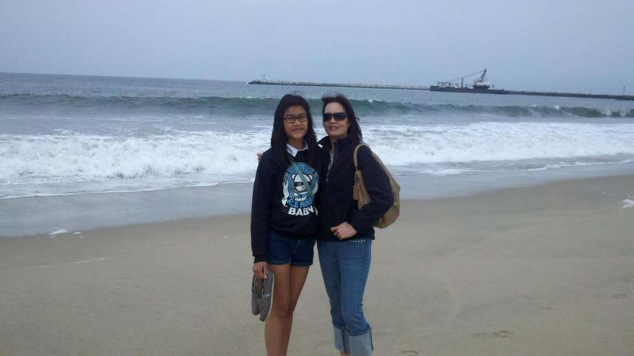 Some mothers and daughters go to the beach together.