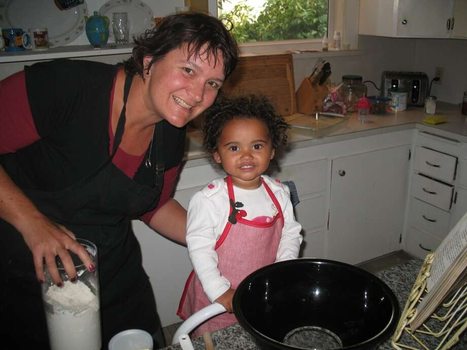 Some mothers and daughters cook together. Photo: Deanna Tibbs