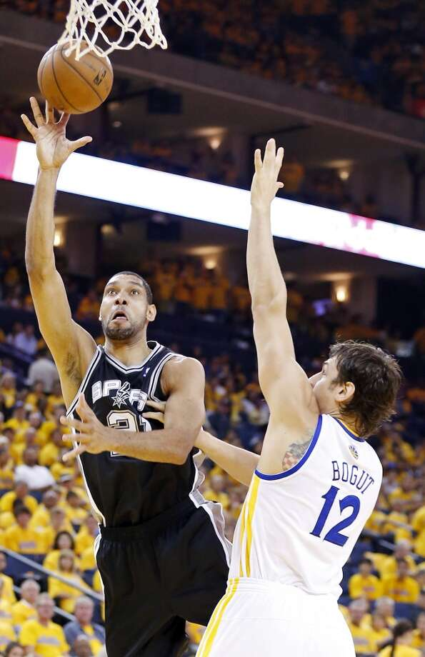 The Spurs' Tim Duncan shoots around Warriors' Andrew Bogut during second half action of Game 3 in the Western Conference semifinals Friday May 10, 2013 at Oracle Arena in Oakland, CA. The Spurs won 102-92.