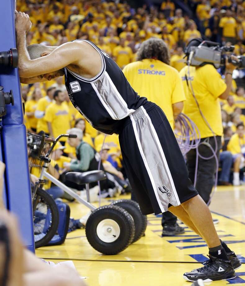 The Spurs' Tony Parker stretches during a timeout in second half action of Game 3 of the Western Conference semifinals against the Golden State Warriors Friday May 10, 2013 at Oracle Arena in Oakland, CA. The Spurs won 102-92.