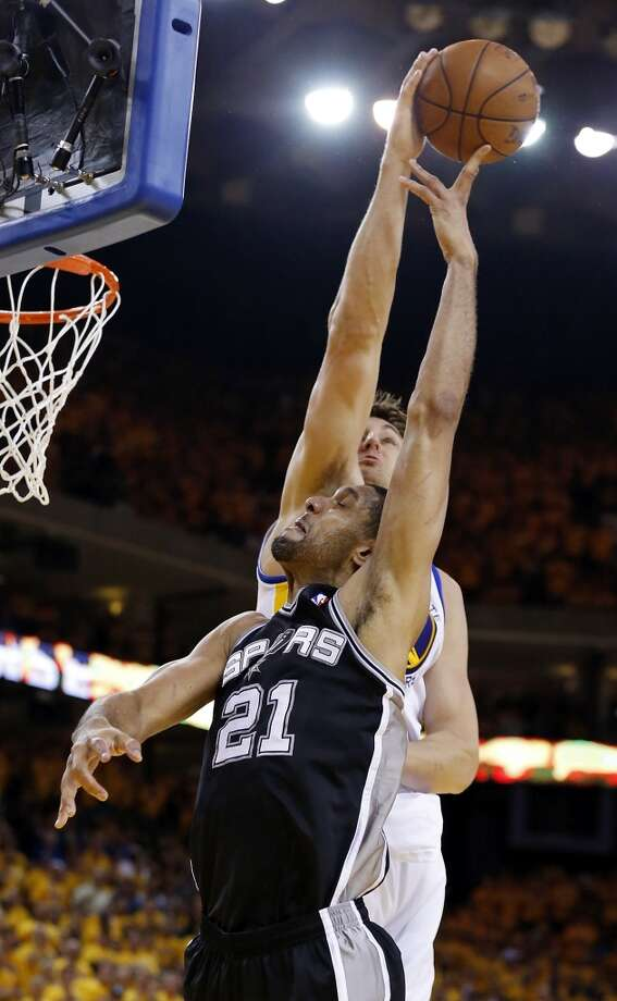 The Warriors' Andrew Bogut blocks the Spurs' Tim Duncan during second half action of Game 3 in the Western Conference semifinals Friday May 10, 2013 at Oracle Arena in Oakland, CA. The Spurs won 102-92.