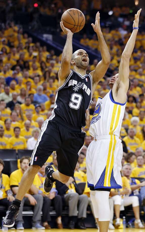 The Spurs' Tony Parker shoots around Warriors' Stephen Curry during second half action of Game 3 in the Western Conference semifinals Friday May 10, 2013 at Oracle Arena in Oakland, CA. The Spurs won 102-92.