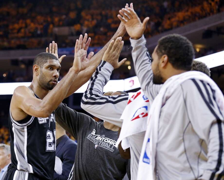 The Spurs' Tim Duncan celebrates with teammates on the bench during second half action of Game 3 in the Western Conference semifinals against the Golden State Warriors Friday May 10, 2013 at Oracle Arena in Oakland, CA. The Spurs won 102-92.