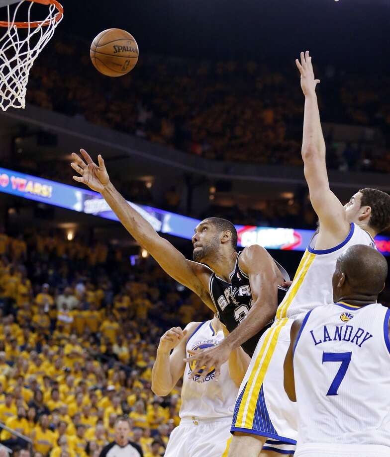 San Antonio Spurs' Tim Duncan shoots between Golden State Warriors defenders during second half action of Game 3 in the NBA Western Conference semifinals Friday May 10, 2013 at Oracle Arena in Oakland, CA. The Spurs won 102-92.