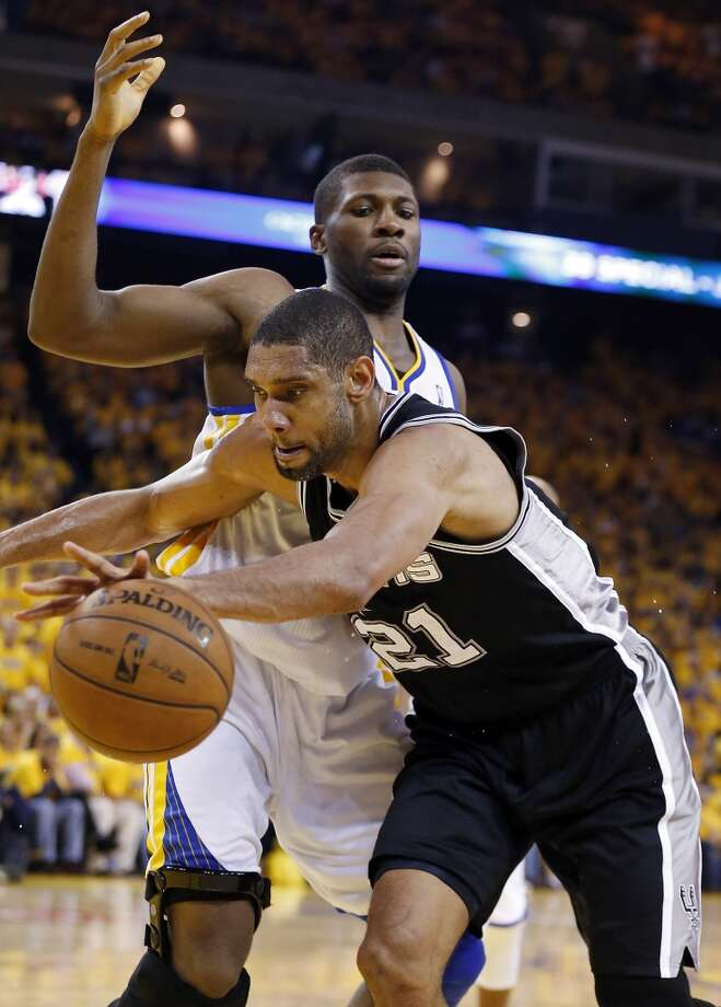 San Antonio Spurs' Tim Duncan looks for room around Golden State Warriors' Festus Ezeli during second half action of Game 3 in the NBA Western Conference semifinals Friday May 10, 2013 at Oracle Arena in Oakland, CA. The Spurs won 102-92.