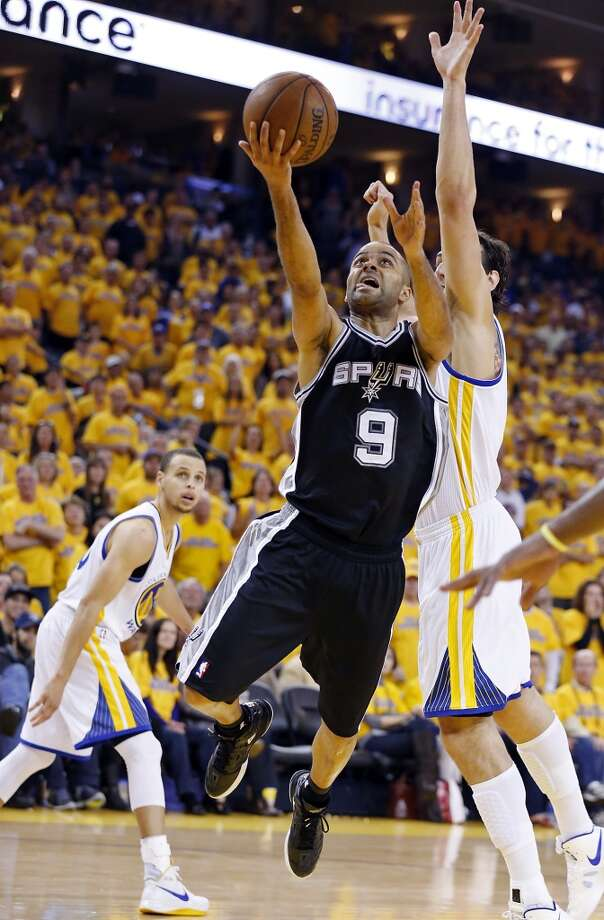San Antonio Spurs' Tony Parker shoots around Golden State Warriors' Andrew Bogut during second half action of Game 3 in the NBA Western Conference semifinals Friday May 10, 2013 at Oracle Arena in Oakland, CA. The Spurs won 102-92.