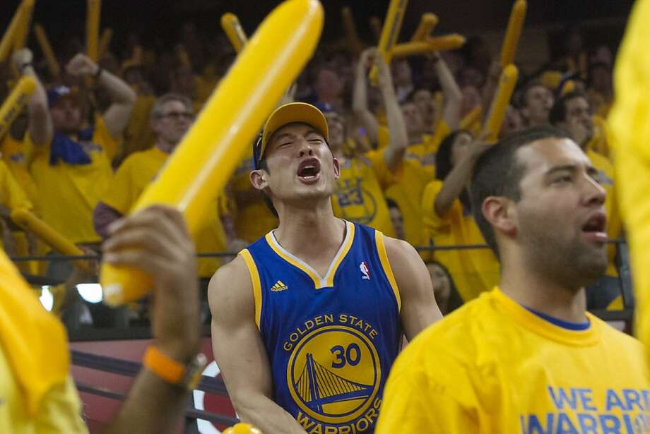 Fan Ben Jiang reacts to a call in last season's playoffs against the Spurs. Photo: Douglas Zimmerman, SF Gate