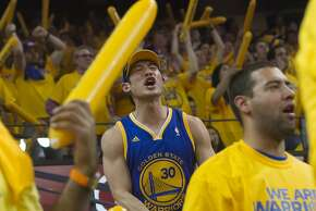 Golden State Warriors fan Ben Jiang of Oakland reacts to a call while  watching the Warriors play the San Antonio Spurs in game 3 of the NBA Western Conference Semifinals at Oracle Arena, in Oakland, Calif. on May 10, 2013.