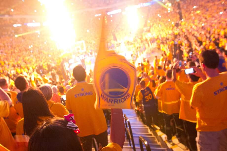 A Golden State Warriors fan cheers the introductions of the Warriors before game 3 of the NBA Western Conference Semifinals against the San Antonio Spurs at Oracle Arena, in Oakland, Calif. on May 10, 2013.