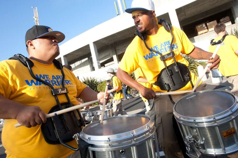 (Left to right) Montoya Williams and James Saltorre of the Warriors drum band, the After Shock, play before the start of game 3 of the NBA Western Conference Semifinals between the Golden State Warriors and  the San Antonio Spurs at Oracle Arena, in Oakland, Calif. on May 10, 2013.