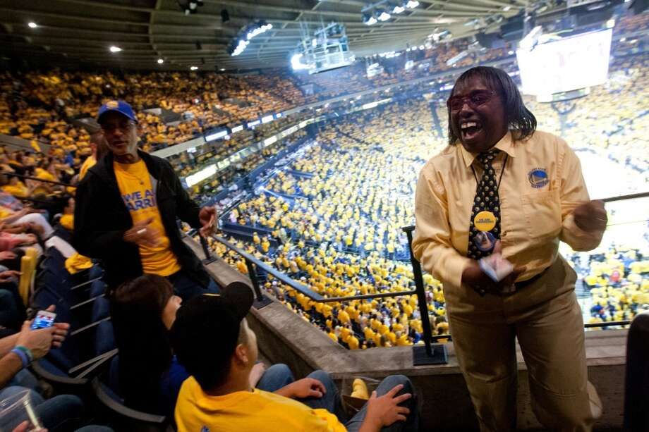 Larry Miller (left, standing) dances with usher Janice P. during a timeout of game 3 of the NBA Western Conference Semifinals between the Golden State Warriors and  the San Antonio Spurs at Oracle Arena, in Oakland, Calif. on May 10, 2013.