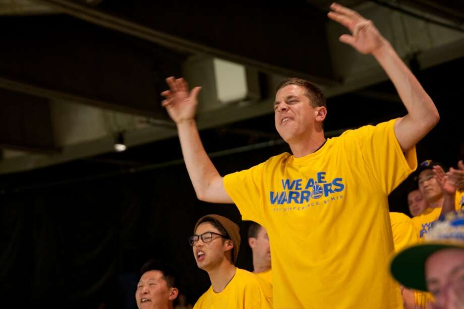Geoff Cohen of Mill Valley urges on the Warriors during the first half of  game 3 of the NBA Western Conference Semifinals between the Golden State Warriors and  the San Antonio Spurs at Oracle Arena, in Oakland, Calif. on May 10, 2013.