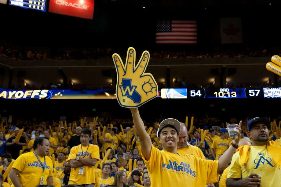 Warriors fans cheer during a time out at the start of the second half of  game 3 of the NBA Western Conference Semifinals between the Golden State Warriors and  the San Antonio Spurs at Oracle Arena, in Oakland, Calif. on May 10, 2013.