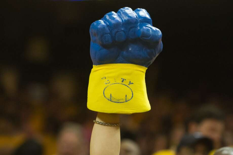 A Warriors fans holds up an oversized foam fist during the second half of  game 3 of the NBA Western Conference Semifinals between the Golden State Warriors and  the San Antonio Spurs at Oracle Arena, in Oakland, Calif. on May 10, 2013.