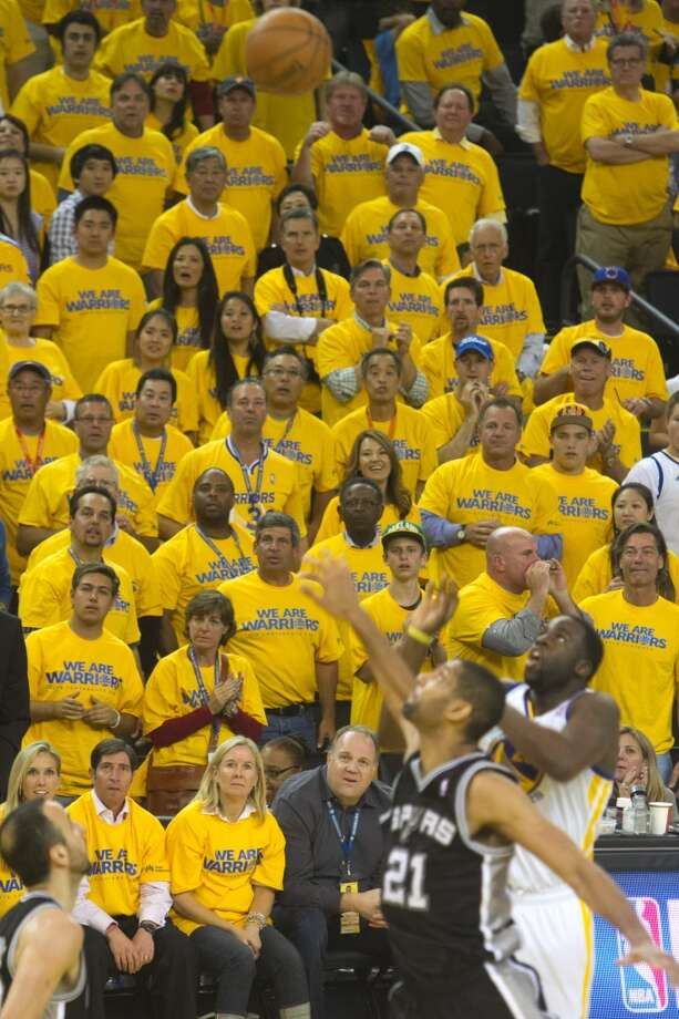The Warriors Draymond Green makes a shot over Tim Duncan as fan watch in the second half of  game 3 of the NBA Western Conference Semifinals between the Golden State Warriors and  the San Antonio Spurs at Oracle Arena, in Oakland, Calif. on May 10, 2013.